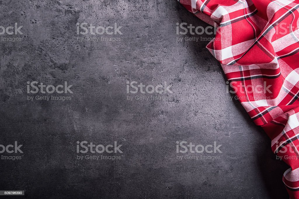 Top view of checkered kitchen tablecloth on table stock photo