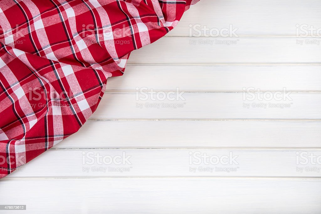 Top view of checkered kitchen towels on wooden table. stock photo