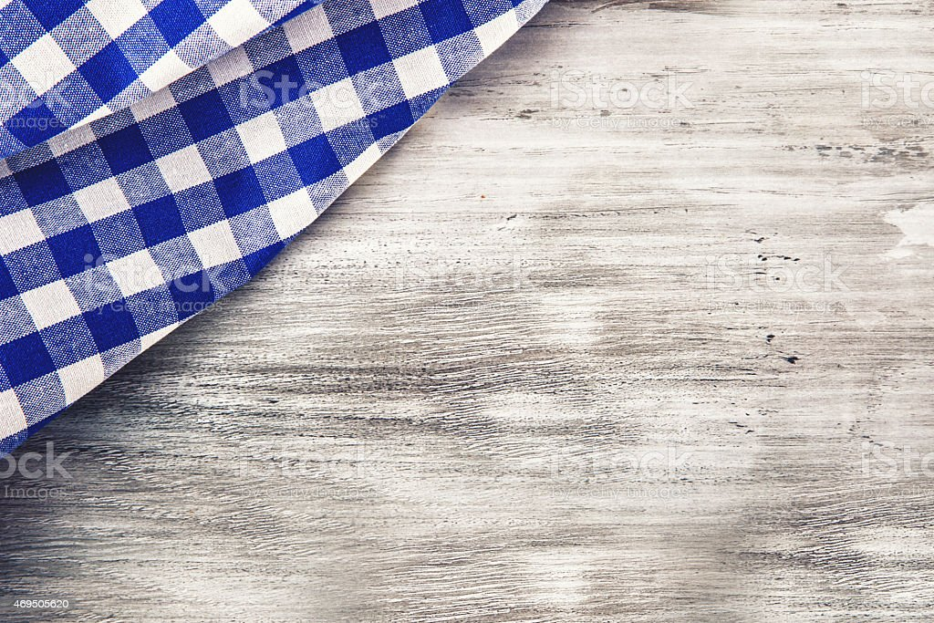Top view of checkered napkin on wooden table. stock photo