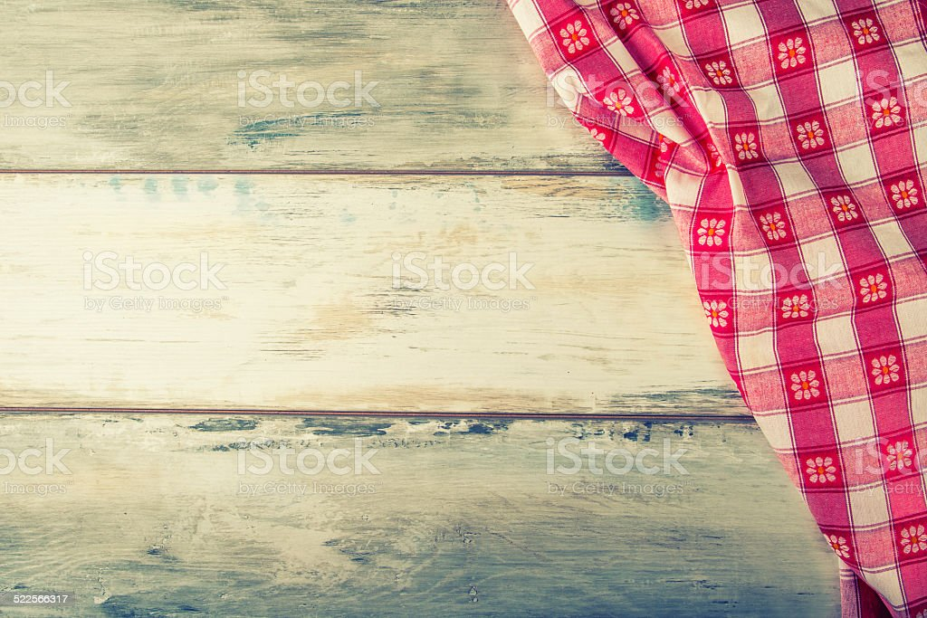 Top view of checkered napkin on wooden table stock photo