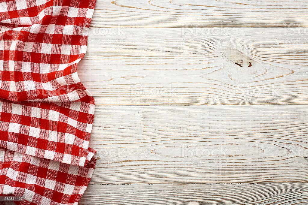 Top view of checkered tablecloth on white wooden table stock photo