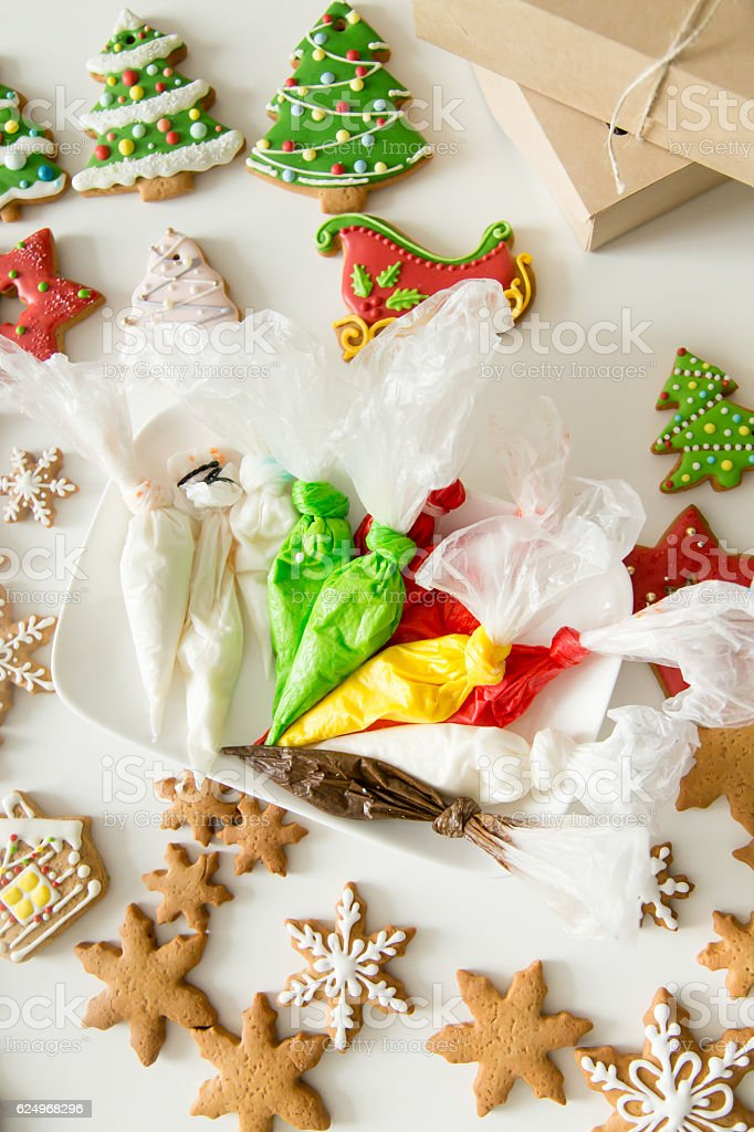 Top view of christmas gingerbread cookies and pastry bags stock photo