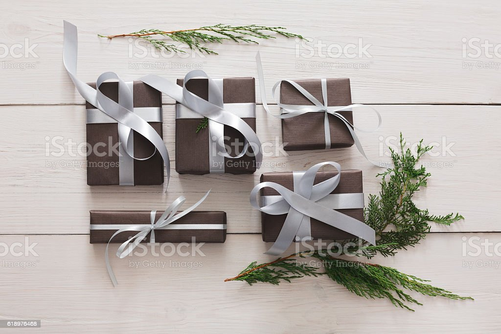Top view of christmas present boxes on white wood background stock photo