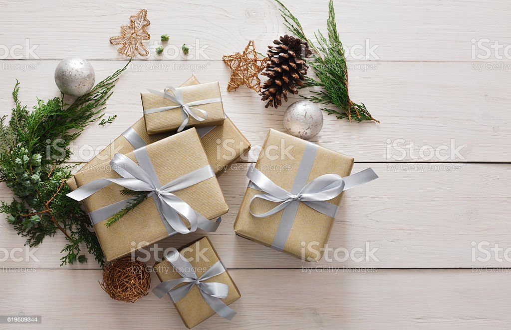 Top view of christmas present boxes on white wood stock photo