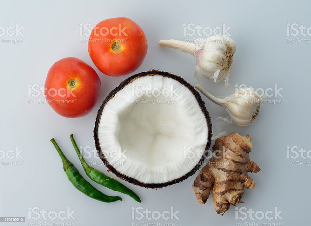 Top View of Coconut,Ginger ,Tomatoes,Garlic and Green Chili stock photo