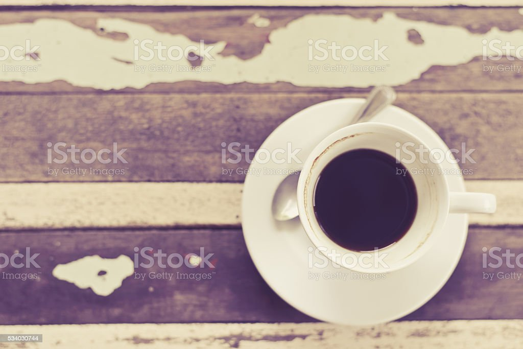 top view of coffee cup on wooden table,vintage style stock photo