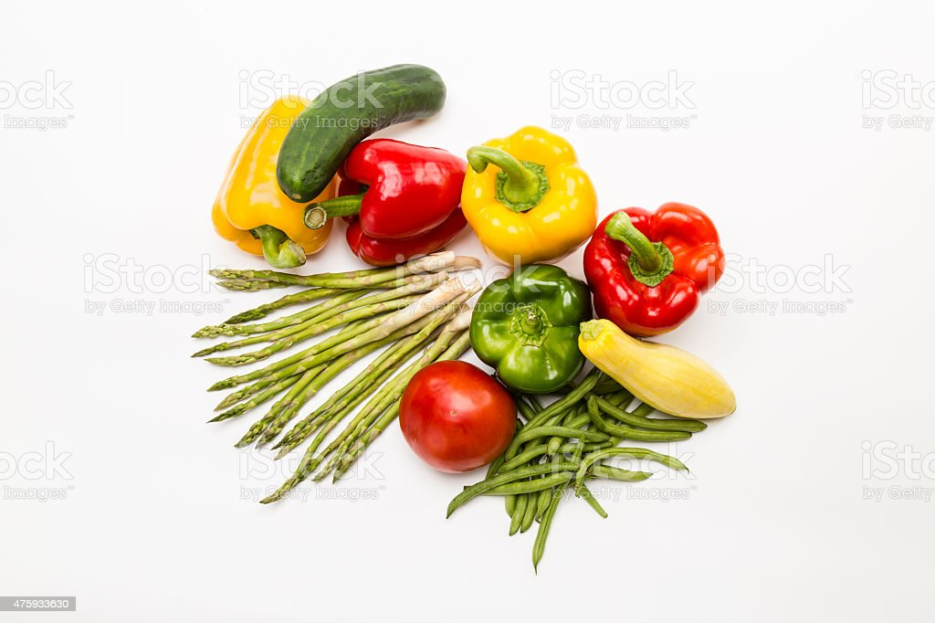 Top view of colorful vegetables on white background. stock photo