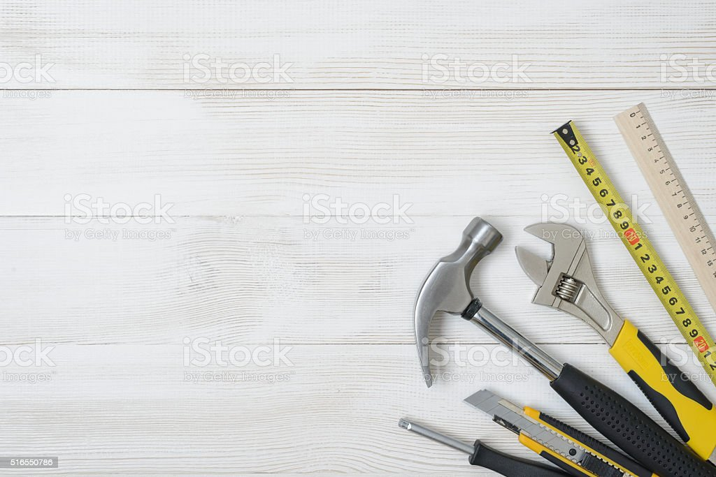 Top view of construction instruments and tools on wooden DIY stock photo