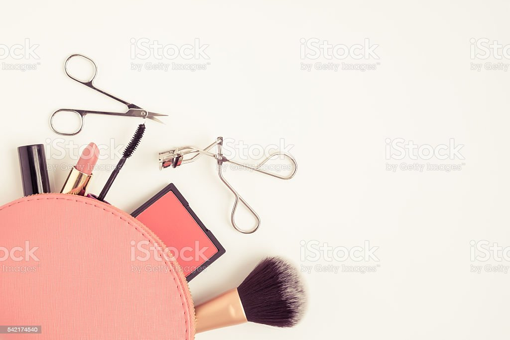 Top view of cosmetic bag with makeup items stock photo