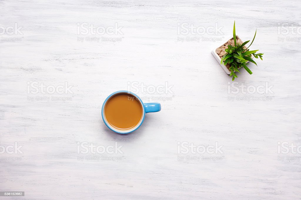 Top view of cup of coffee on white wooden background stock photo