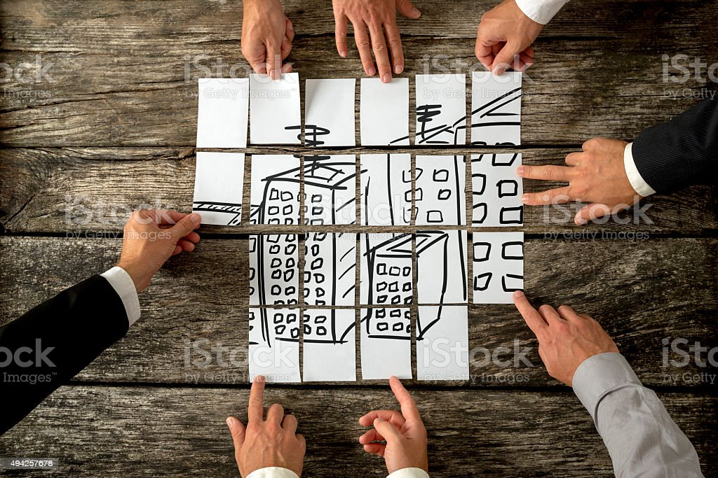Top view of eight architects cooperating in urban development stock photo