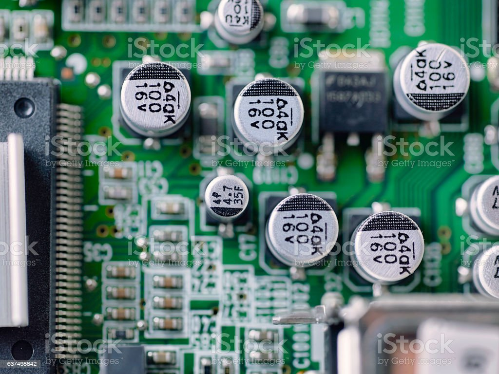 Top view of electronic microcircuit with capacitors taken closeup. stock photo