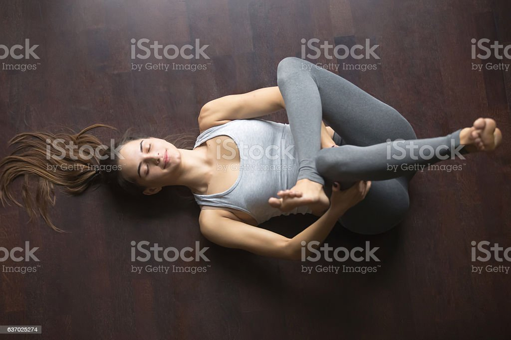 Top view of Eye of the Needle yoga pose stock photo