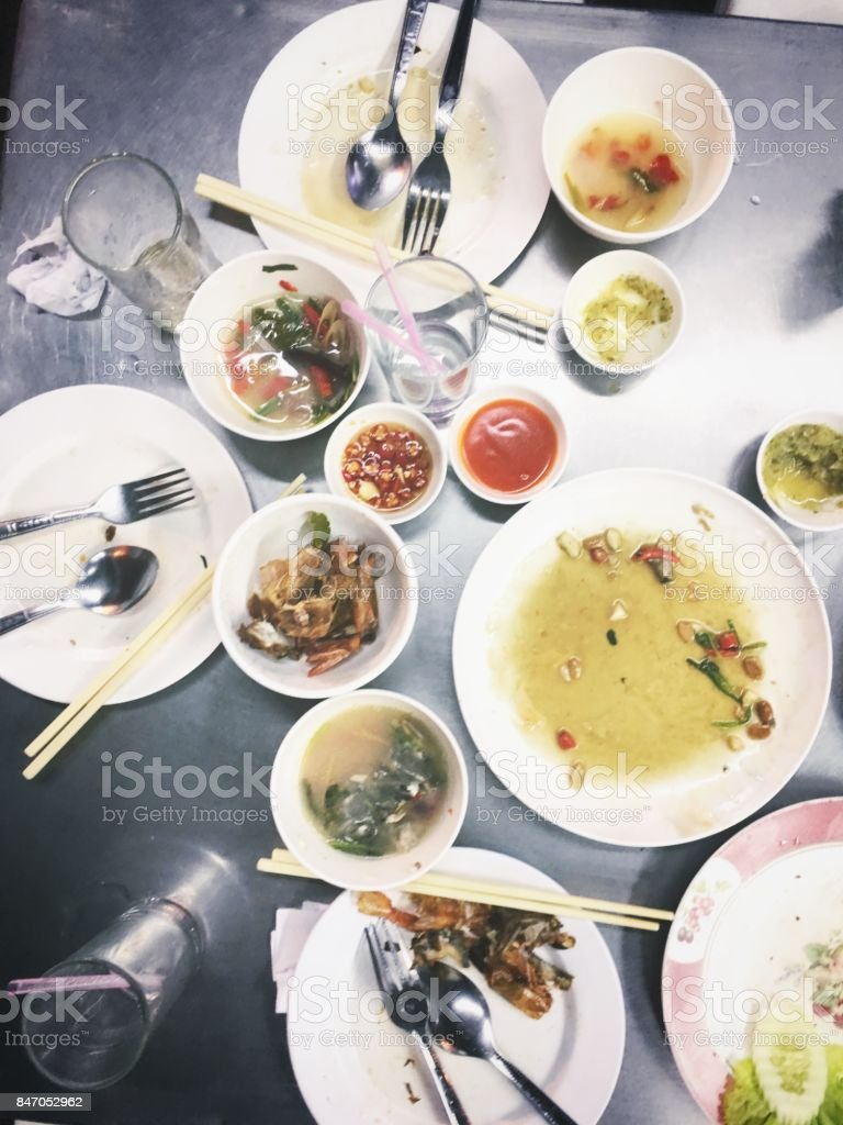 Top view of family having dinner in restaurant flat lay with...
