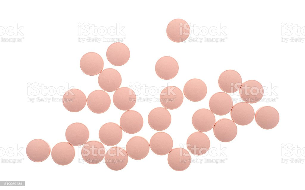 Top view of famotidine pink tablets on a white background stock photo