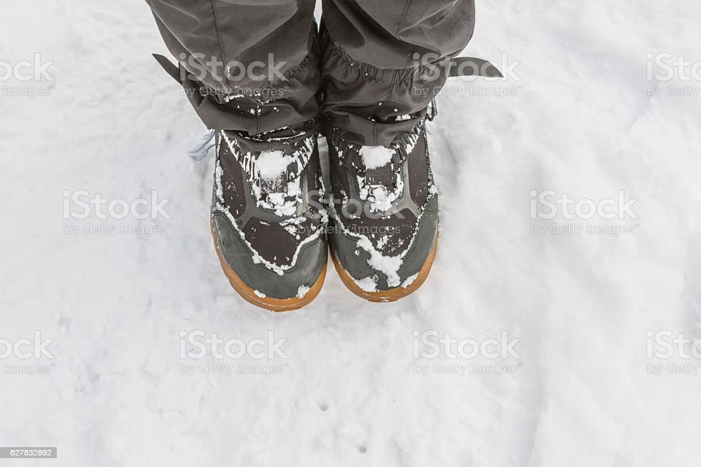 Top view of feet in boots and gaiters snow protection stock photo