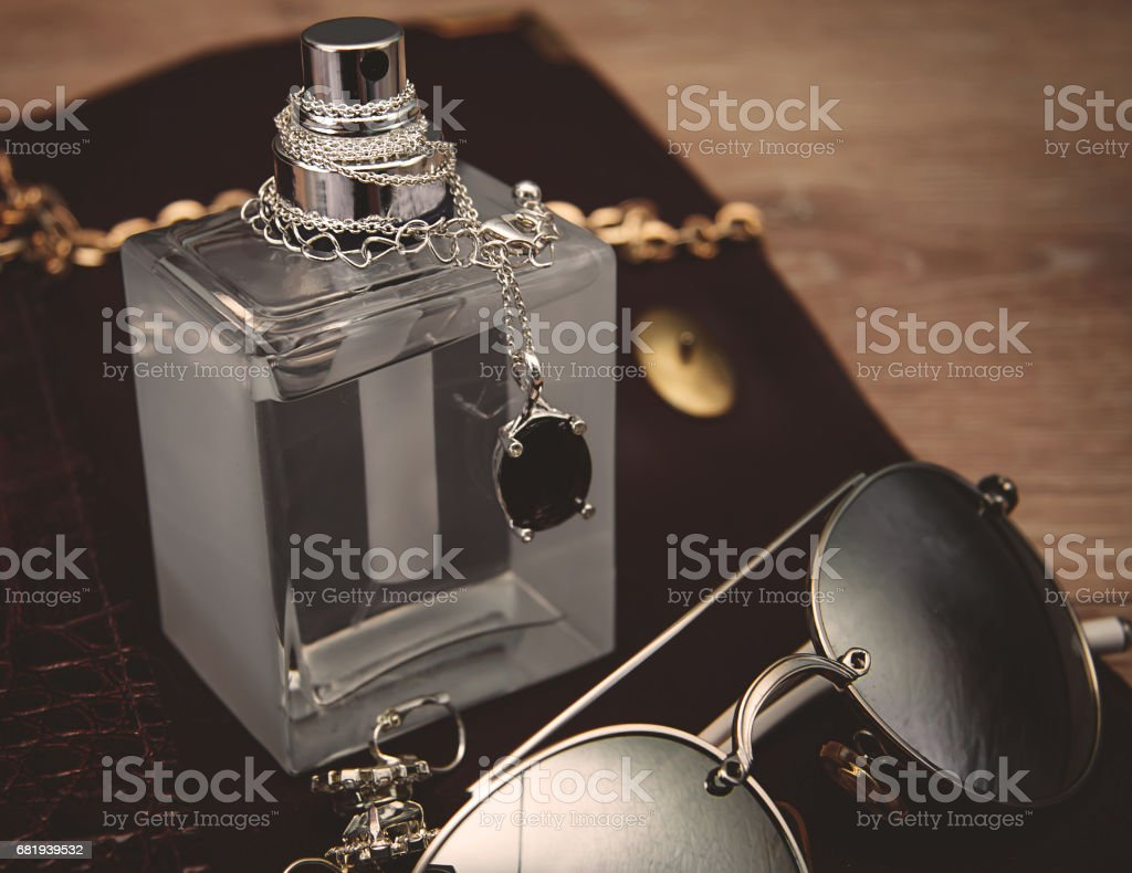 Top view of female fashion accessories. Perfume with sunglasses stock photo