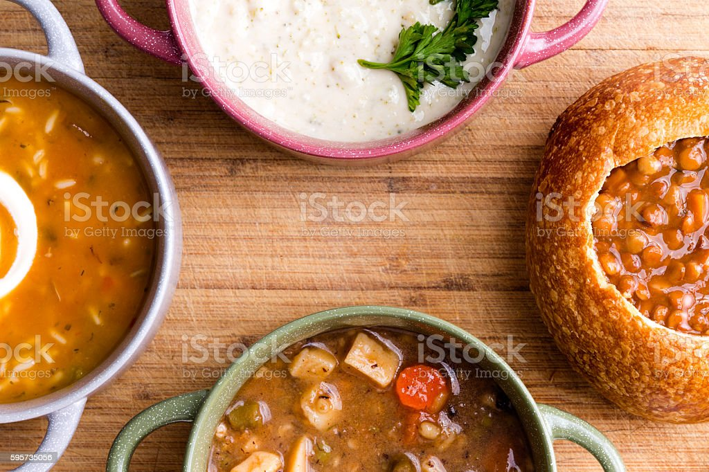 Top view of four types of soup and bowls stock photo