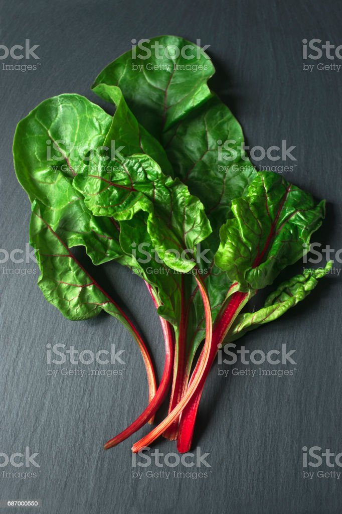 Top view of fresh beet leaves on the dark background stock photo