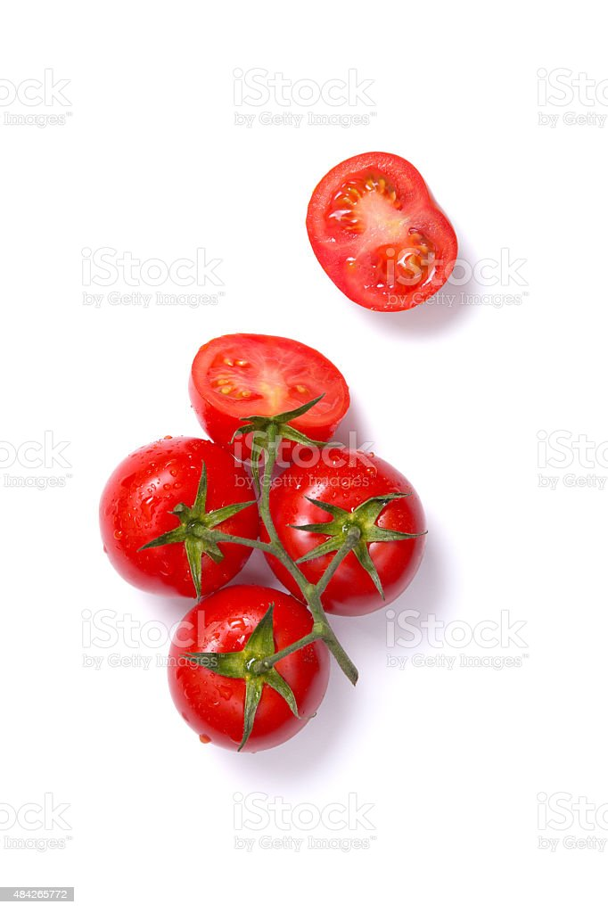 Top view of fresh tomatoes, whole and half cut stock photo
