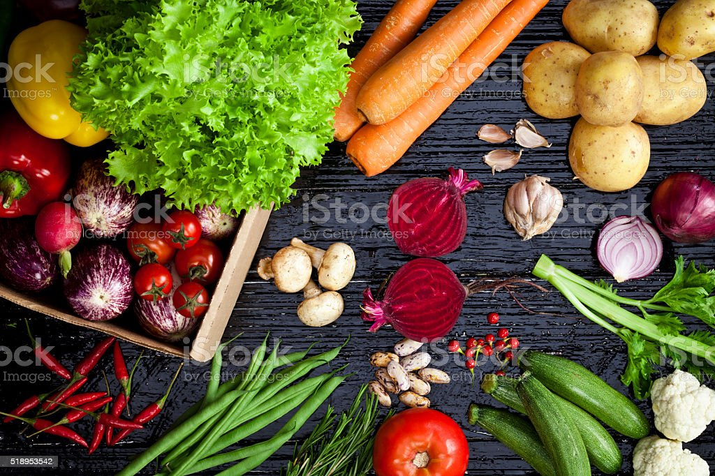 Top view of fresh vegetables on dark background stock photo