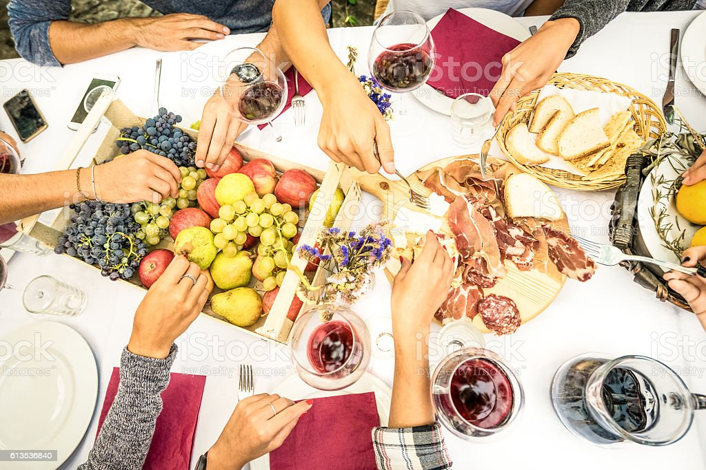 Top view of friend hands on wine at garden party stock photo