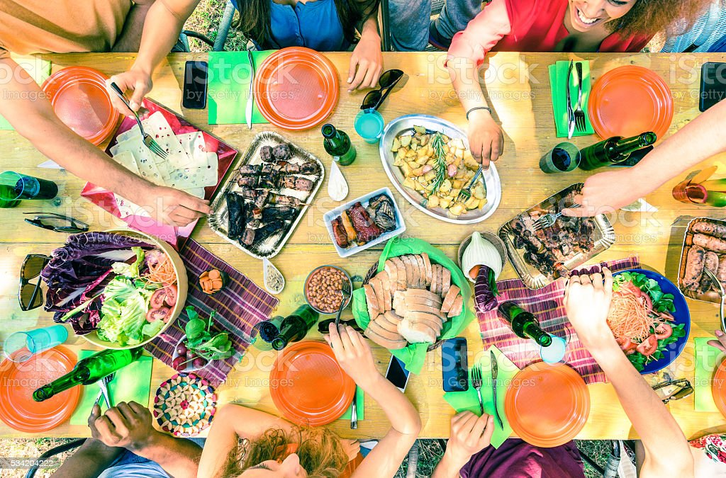 Top view of friend hands serving food at barbecue party stock photo
