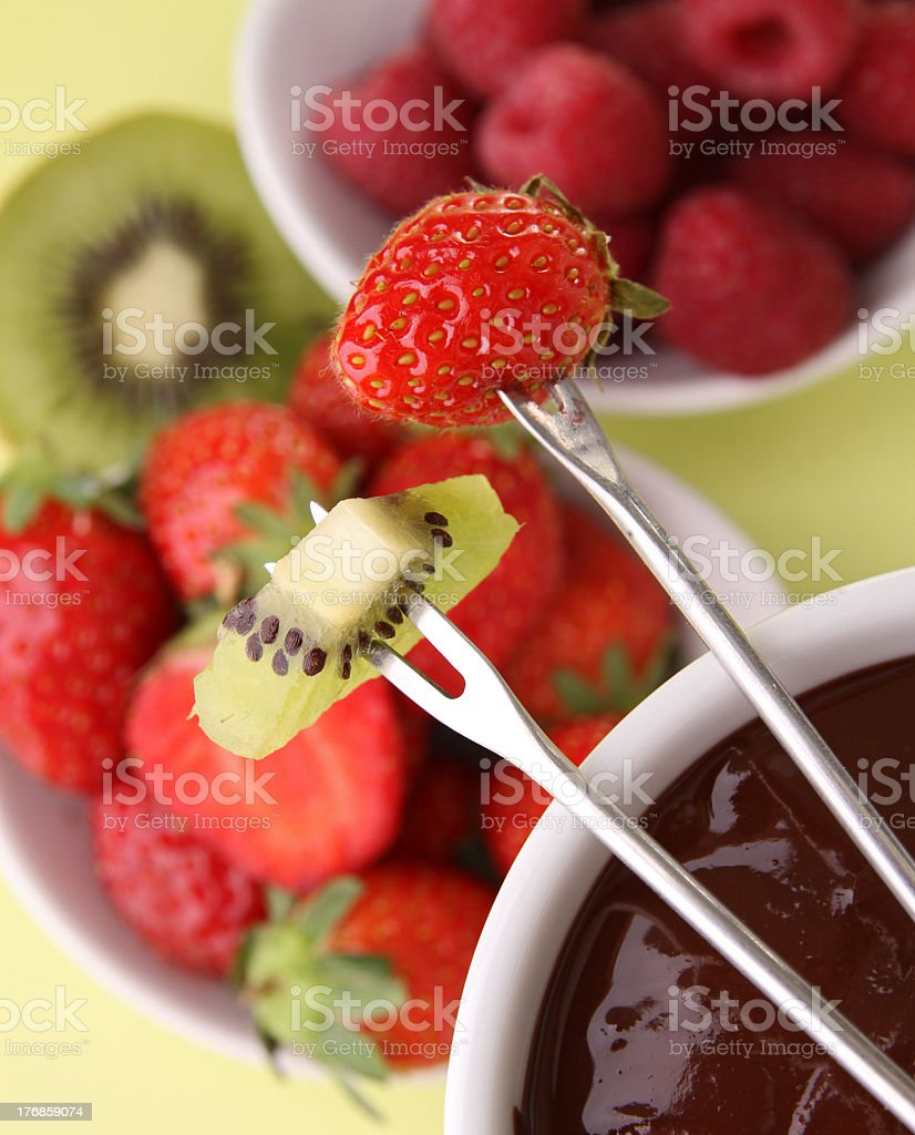 Top view of fruit on fondue fork ready for chocolate dipping royalty-free stock photo
