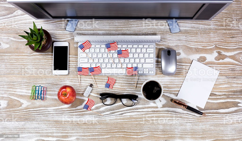Top view of full desktop with small USA flags stock photo