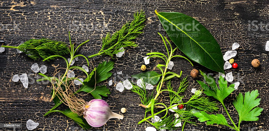 top view of garlic, dry peppers, sea salt, different greenery stock photo