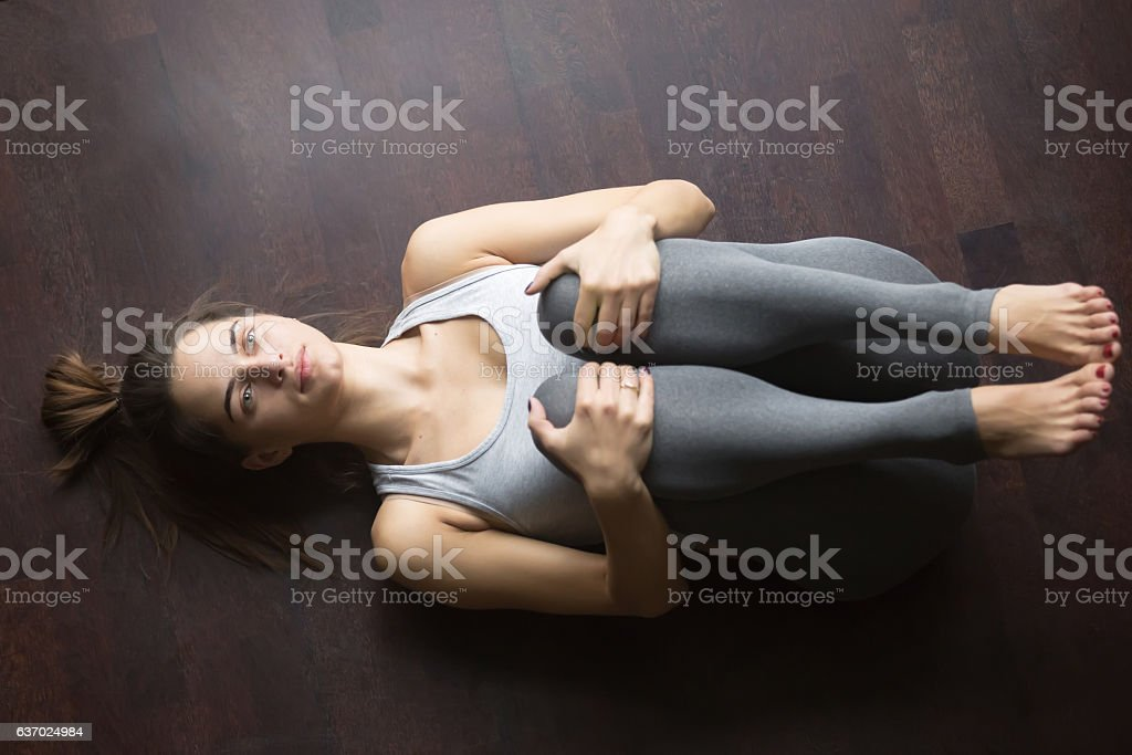 Top view of Gas Release yoga posture stock photo