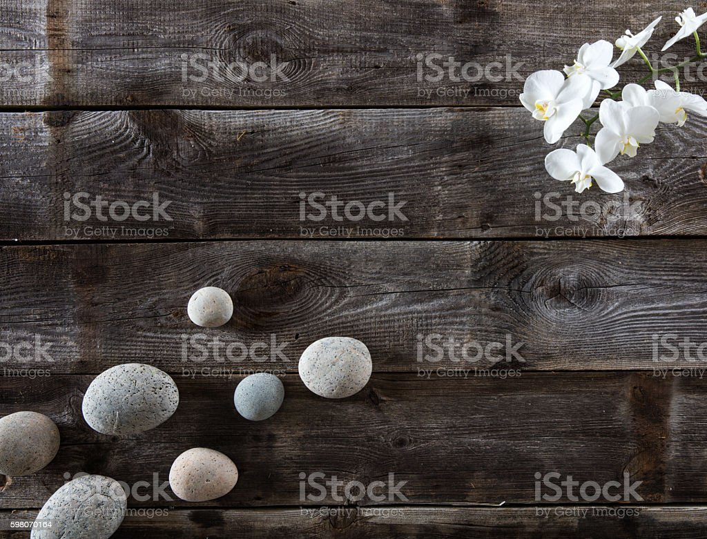 top view of genuine wood background with pebbles and orchids stock photo