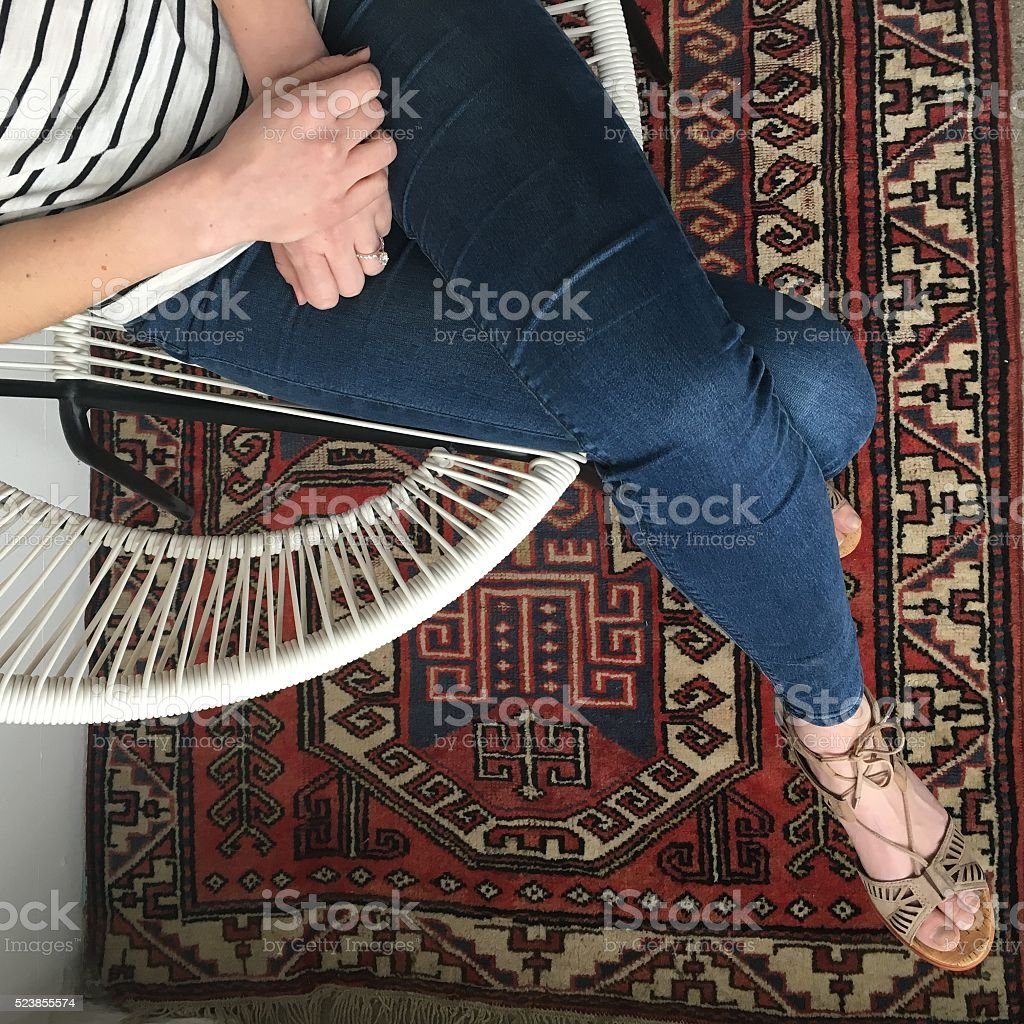 top view of girl sitting in a chair stock photo