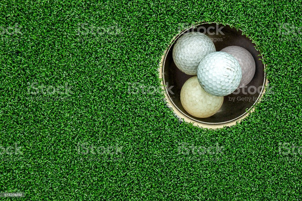 Top view of golf balls stacked up in green field stock photo