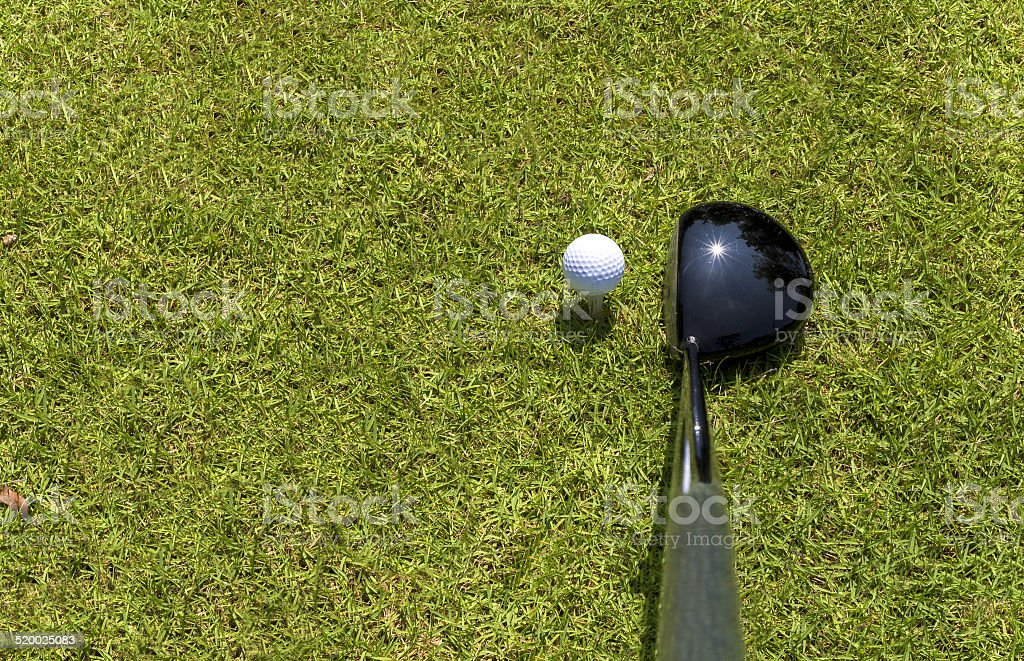 Top view of golf driver and ball on tee