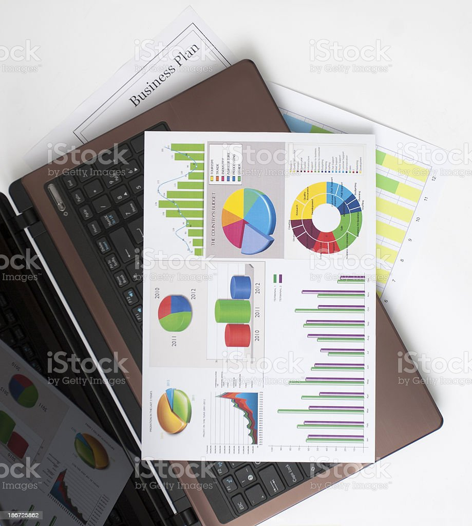 Top view of graphed business plan on top of laptop computer royalty-free stock photo