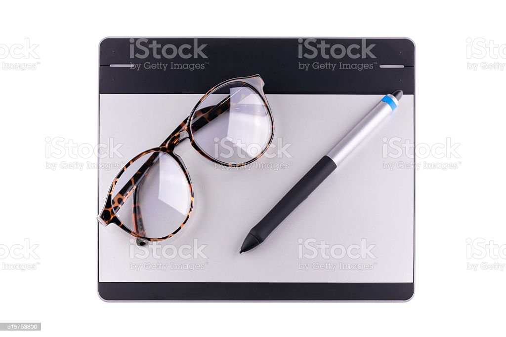 Top view of graphic tablet with pen and retro glass stock photo
