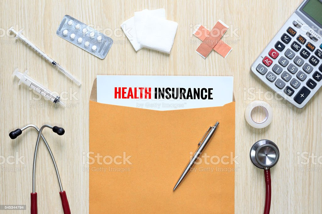 Top view of Health Insurance with letter envelope, medical device stock photo