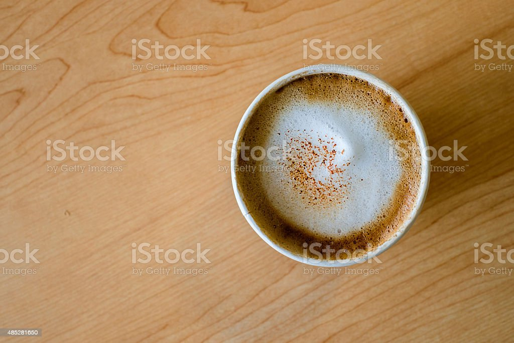 Top view of hot capuccino coffee in paper cup stock photo
