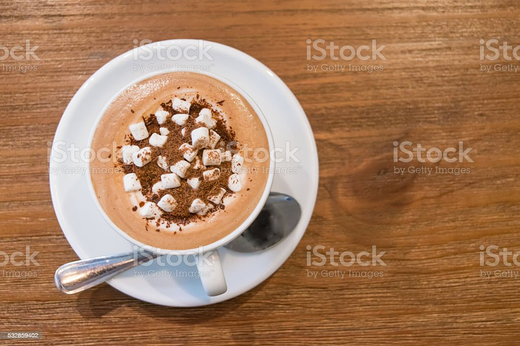 Top view of hot milk chocolate on wooden table stock photo