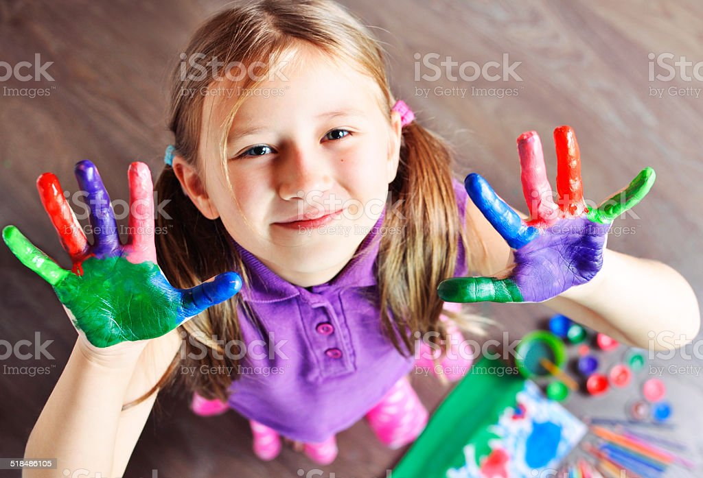 Top view of Little Girl with painted hands stock photo