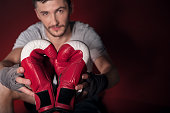 Top view of man holding boxing gloves