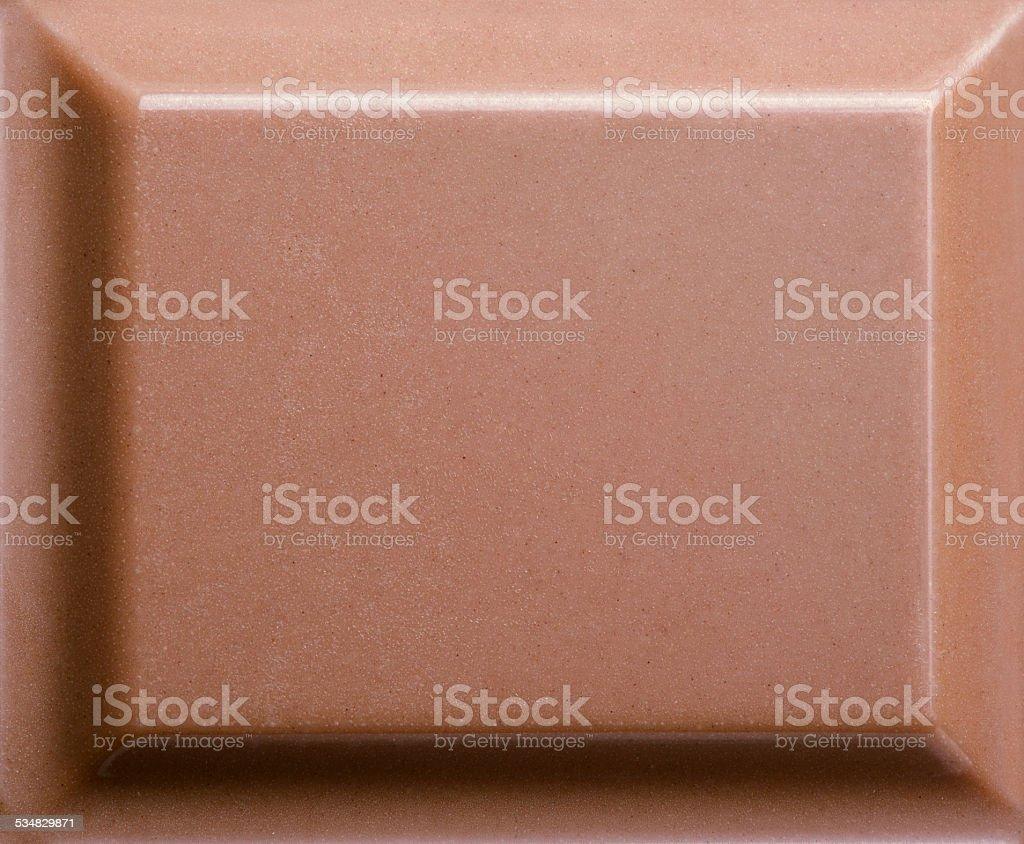 Top view of milk chocolate piece stock photo