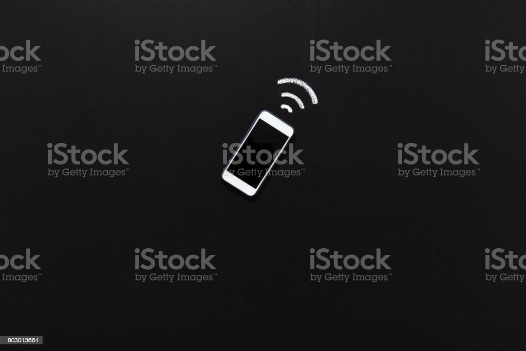top view of modern smartphone with blank screen and connection sign isolated on black stock photo