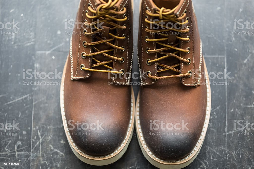 Top view of new leather lace-up boots. stock photo