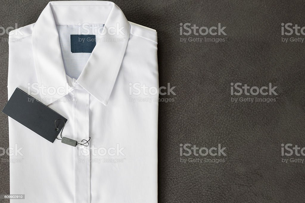 Top view of new white Shirt on gray deerskin background stock photo