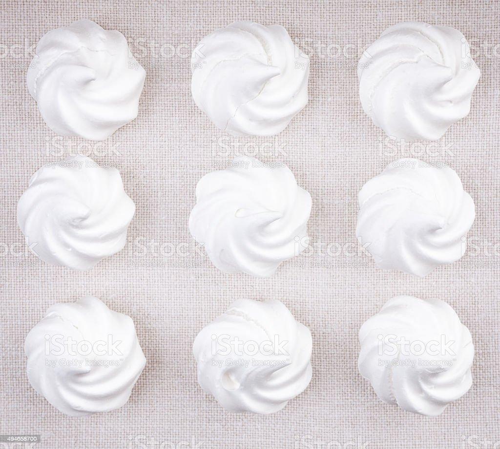 Top view of nine white meringue cookies stock photo