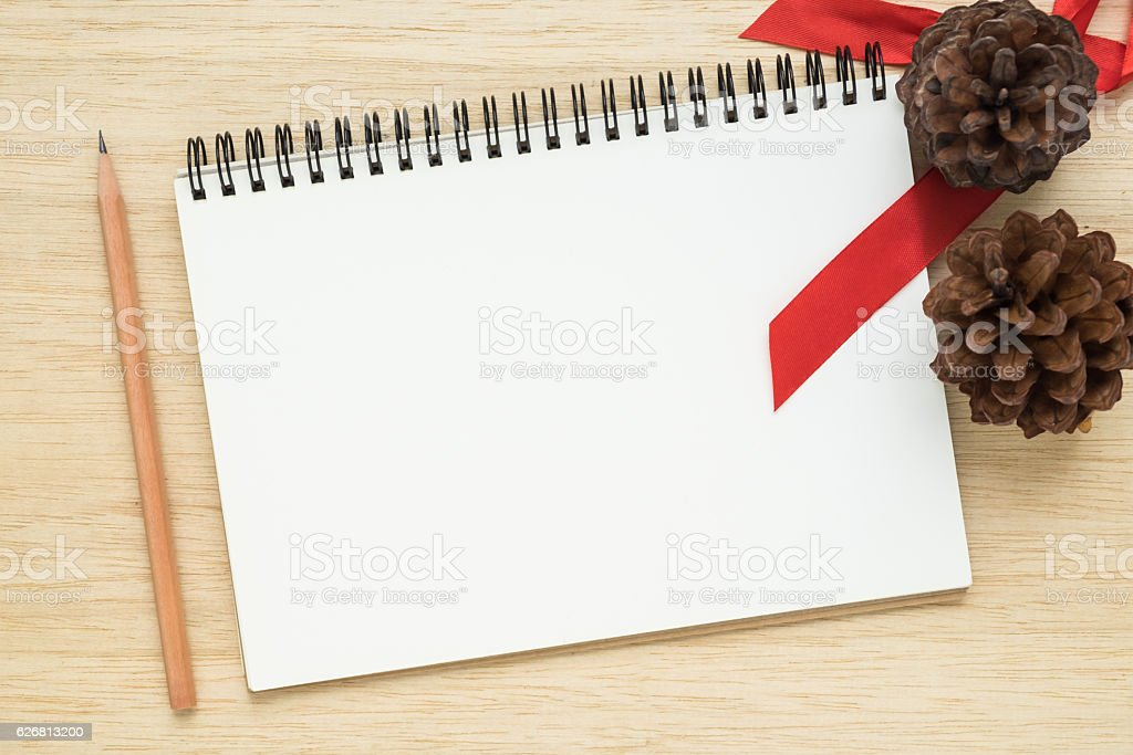 Top view of notebook on wooden background stock photo
