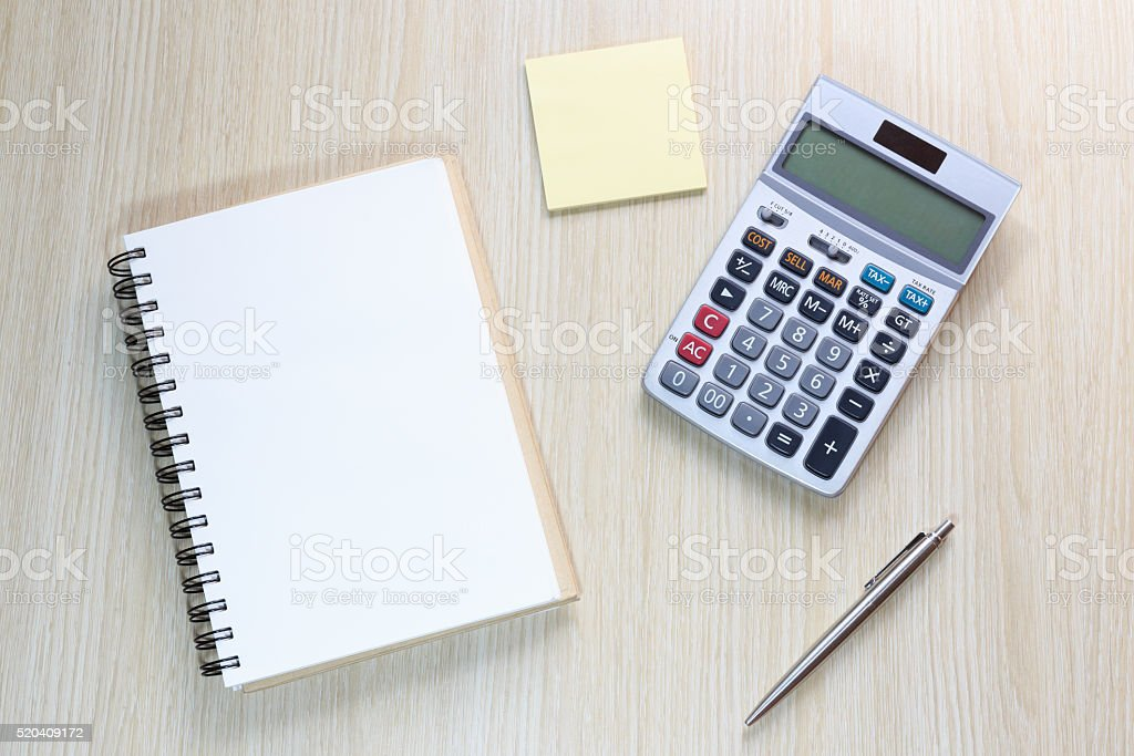 Top view of office desk  with notebook and calculator stock photo