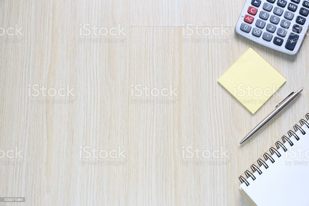 Top view of office desk  with notepad, note, and calculator stock photo